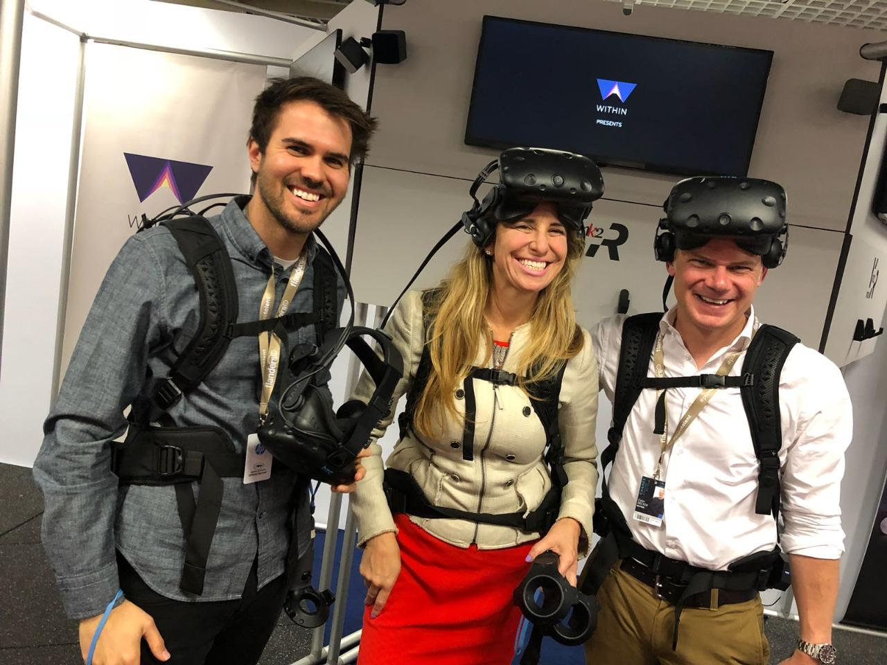 "WITHIN co-founder and CTO Aaron Koblin, HP's Joanna Popper and Colin Decker, WITHIN chief operating officer, trying out ""Chorus,"" a location-based VR experience, presented at the Cannes Film Festival."