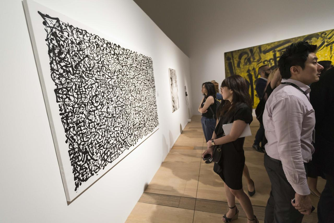 A visitor studying a work by the French artist Tanc at the ArtScience Museum in Singapore.