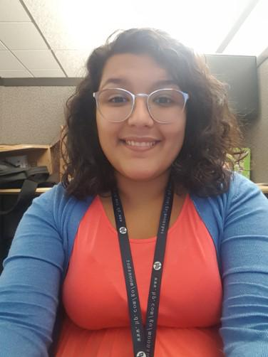 Isabella Torres, a senior at the University of Houston, digs into complex data at HP's Houston offices to better understand HP customers.