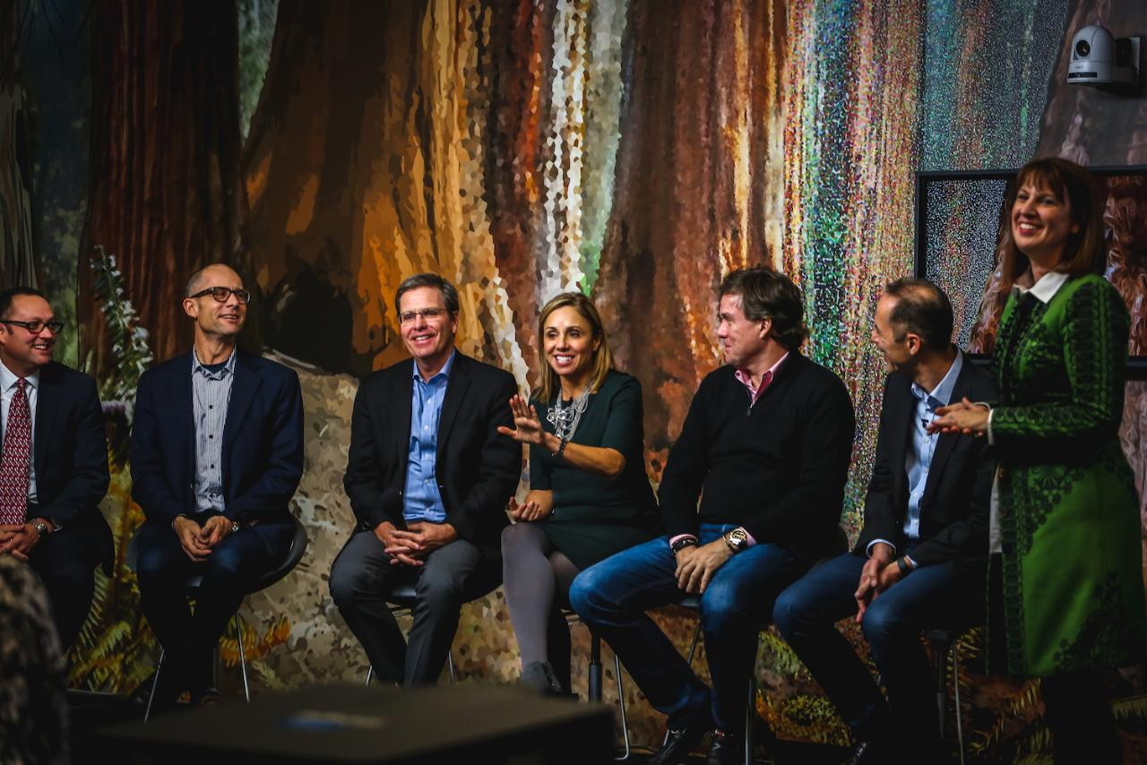 Rivera sitting with her leadership team during an all-hands meeting for HP's Global Legal Affairs group.