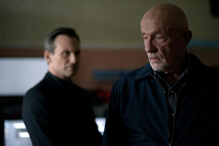 Slater as the Wolf and Jonathan Banks as the Fixer.