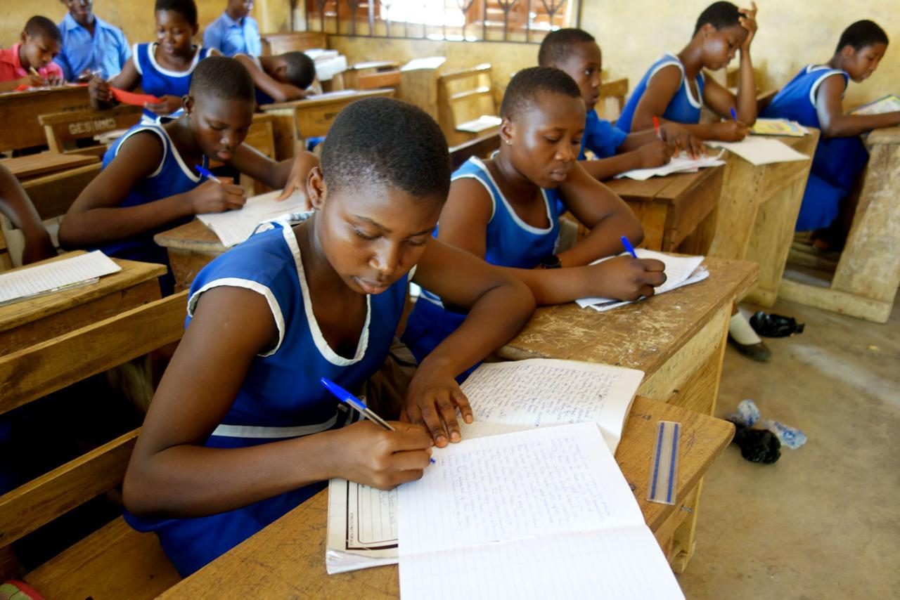 Students work on their stories at a Rakonto workshop in Ghana.